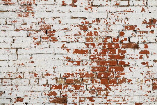 fading white painted red brick wall background