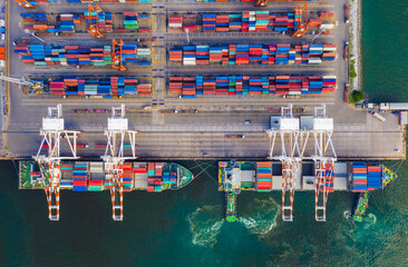 top view of industrial port with containers in import-export business logistic transportation of international port with vessels in port