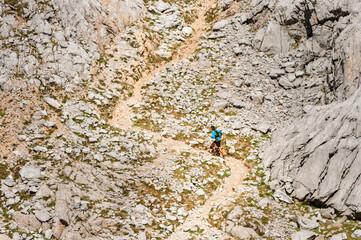 Trail runner running uphill following path