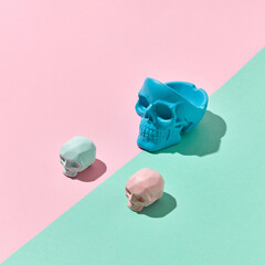 Three colorful skulls with shadows.