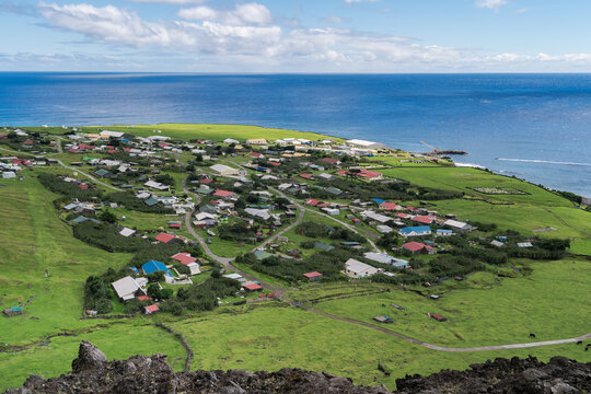 High Angle View Of Village And Sea Against Sky