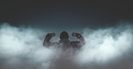 High Angle View Of Man In Fog Against Sky At Night