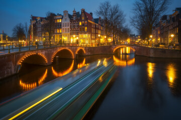 Amsterdam city canal old town, Netherlands. Beautiful iconic view illuminated at night