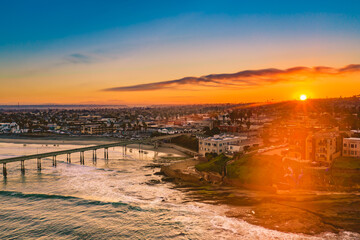 Aerial View Of Townscape By Sea Against Sky During Sunset - fototapety na wymiar