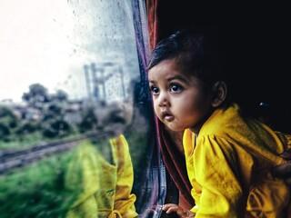 Girl Looking Away Through Train Window Fototapete