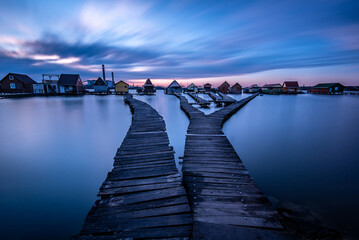 Fotomurales - Pier Over River Against Sky At Dusk