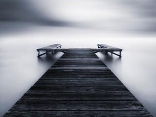 Empty Wooden Jetty On Pier Against Sky