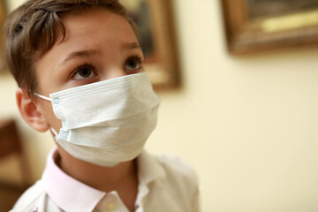 Kid wearing medical protection mask in museum
