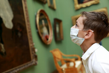 Child wearing protection mask in picture gallery