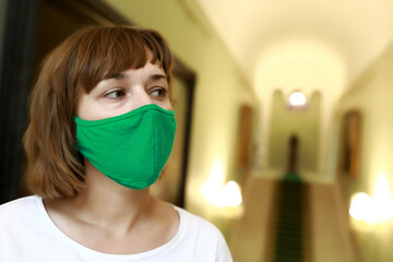 Woman wearing medical protection mask in museum