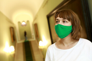 Woman wearing medical protection mask in picture gallery