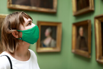 Woman wearing protection mask in museum