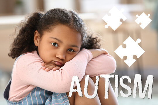 Little African-American girl with autistic disorder sitting at home