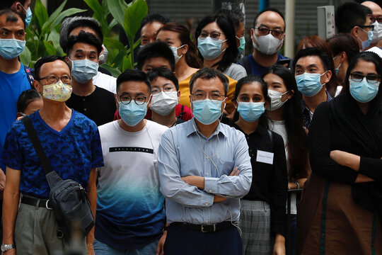People wear surgical masks to prevent the spread of the coronavirus disease (COVID-19), in Hong Kong