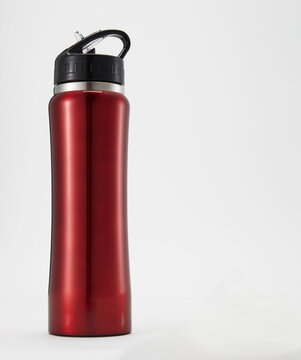 Full length red aluminium waterbottle. Isolated on white background.