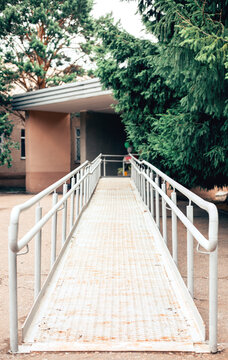 Metal ramp to support wheelchair users. Accessible environment for people with disabilities.
