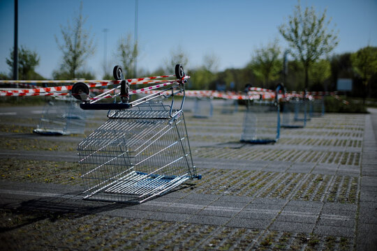 Closed Parking Lot Barrier With Shopping Cart And Barrier Tape