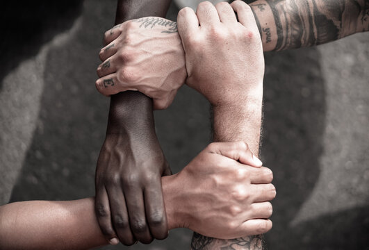 Multiethnic  people with black, latin, caucasian and asian hands holding each other wrist. tolerance, teamwork and anti racism concept. Image