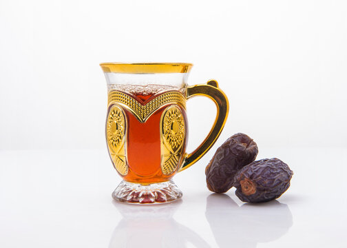 Arabic tea is popular throughout Arab world and it is served in a traditional cups with sweet dates . Sulaimani black tea with ripen date fruits.
