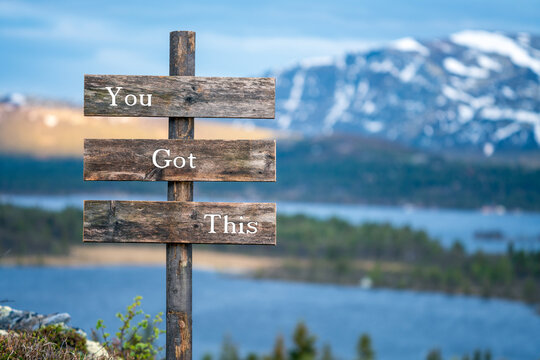you got this text on wooden signpost outdoors in landscape scenery during blue hour and sunset.
