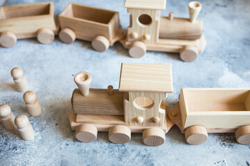 Children's wooden toys. Children wooden train with wagons. Natural wood construction set. Educational equipment. Children's wooden locomotive with various cargo