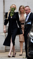 Actor Amber Heard leaves the High Court in London