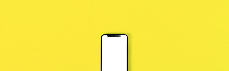 Keuken foto achterwand Zwavel geel Blank smartphone on yellow background. 黄色背景の上に置かれたスマホのブランク素材