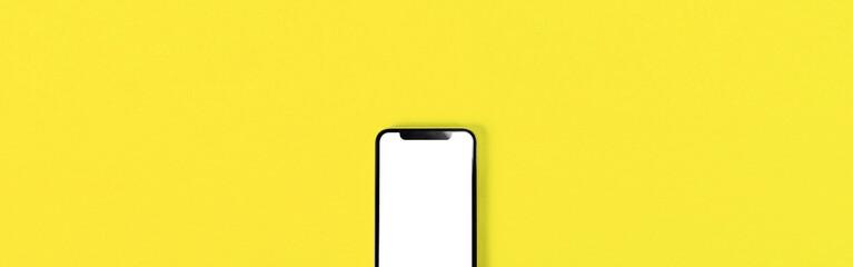 Blank smartphone on yellow background. 黄色背景の上に置かれたスマホのブランク素材
