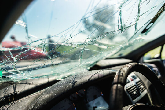 Closeup of crashed car window in car accident.