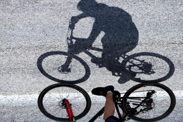 Shadow and creative visual of the adventurer on the bike tour