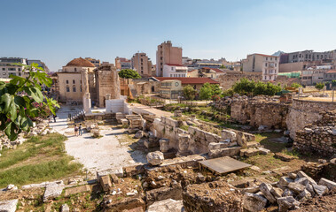 Fototapete - Cityscape of Athens, Library of Hadrian in foreground, Greece. This place is tourist attraction of Athens city. Urban landscape of Athens