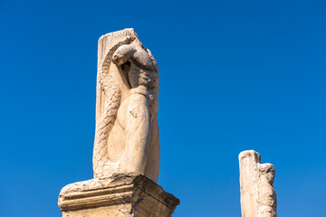 Wall Mural - Statues of mythological heroes in Ancient Agora, Athens, Greece. View of big majestic statues on blue sky background in Athens center.