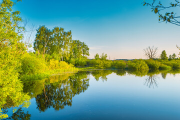 Lake water sunset and nature autumn landscape with blue sky