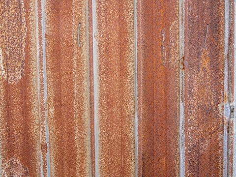 Brown rusty stain on corrugated zinc panel outdoor