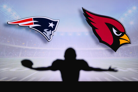 New England Patriots vs. Arizona Cardinals . NFL Game. American Football League match. Silhouette of professional player celebrate touch down. Screen in background.