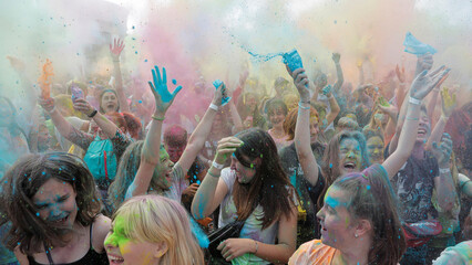 People daubed in coloured powder react during the ColorFest festival at the amusement park 'Dreamland' in Minsk