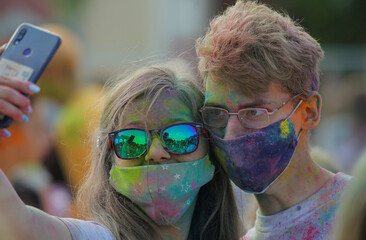 People take selfie during the ColorFest festival at the amusement park 'Dreamland' in Minsk
