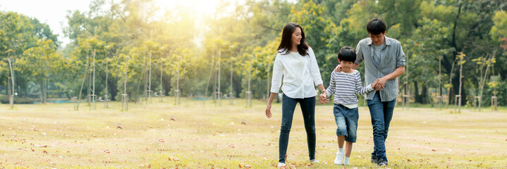 Happy young family spending time together outside, Thai Asian parents take kid to relax in park or garden far away from busy people and covid19, enjoy life and happiness
