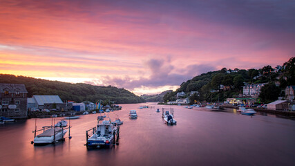 Wall Mural - Red Sunset over Looe harbour, cornwall, South England