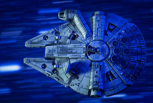 NEW YORK USA - MAY 23 2020: scene from Star Wars - Corellian freighter Millennium Falcon travels through Hyperspace - Kessel Run - X-Wing miniature game ship