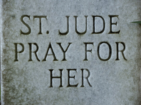 "Closeup of headstone inscribed with text ""St Jude Pray for Her"""
