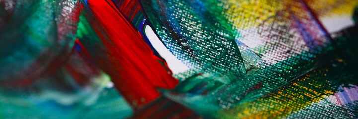 Close-up view of mixed colours on canvas. Chaos illustrated on painting. Fragment of artwork. Oil...
