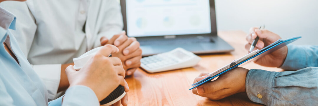 Young couple and real estate Financial Advising agent using laptop on a meeting about Accounting Calculating Cost Economic bills Financial concept