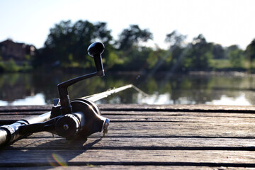 Fishing. Rod, spinning reel on the river bank. Fishing for pike, perch, carp. Wild nature. Lake in...