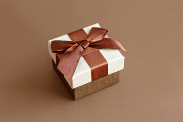 Brown tones gift box on a brown background