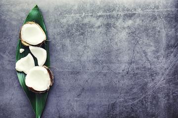 Coconut on a dark stone table. Coconut oil.