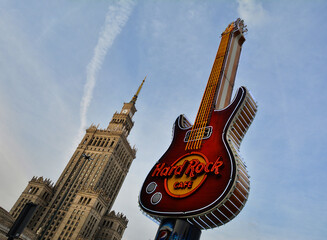 WARSAW, POLAND - JUNE 27, 2018. Citiscape with old  Palace of Culture and Science of Warsaw and new symbol of Hard Rock Cafe in Warsaw, Poland.