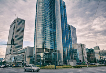 WARSAW, POLAND - JUNE 27, 2018. Cityscape with building architecture and street transportation in Warsaw, capital of Poland,