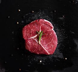 Raw meat steak Tenderloin fillet, on black stone plate