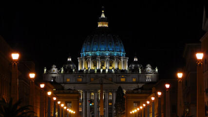 Night in Rome. View of the iconic St Peter dome illuminated, in the city historic center